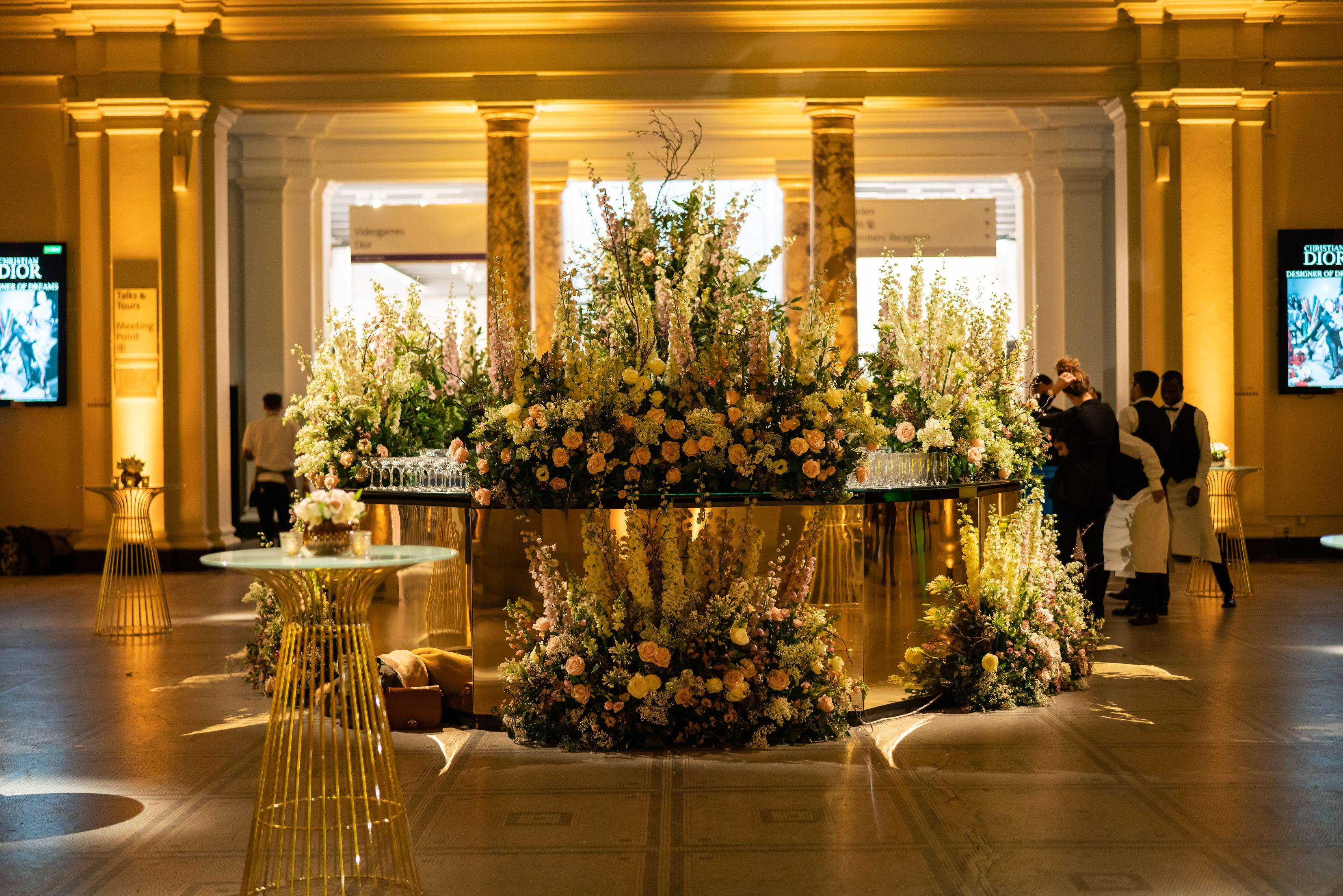 Flower meadow bar, gold wrapped bar, flower wrapped bar, The Dome V&A, London event planners at the V&A